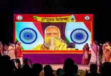 Prime Minister Narendra Modi gestures as he inaugurates a Durga Puja pandal, via video conferencing, in New Delhi.