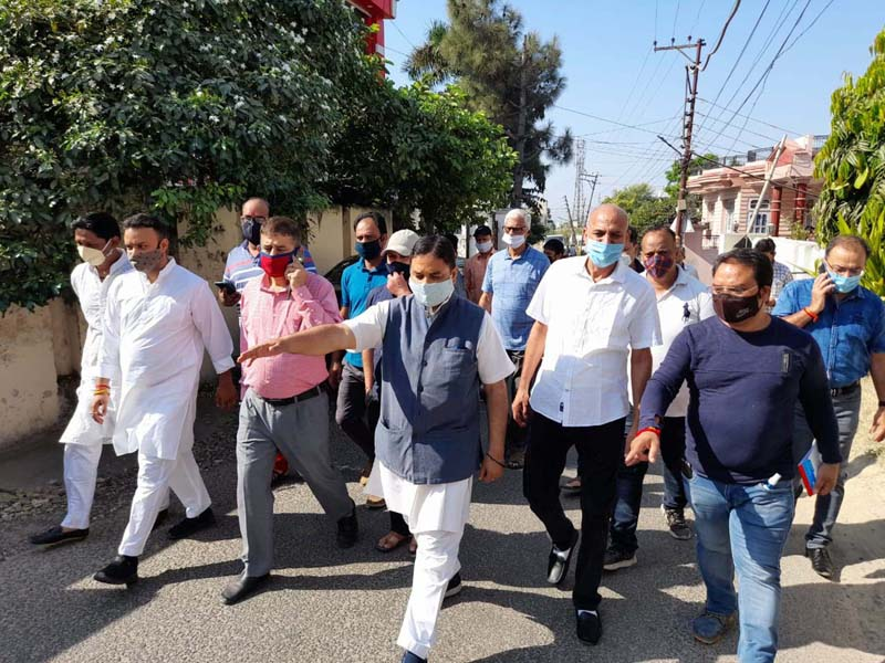 Former Minister, Sat Sharma during tour of Ward 35 on Saturday.