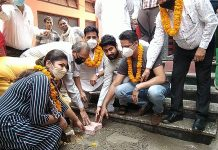 Municipal Councillor, Rakesh Malhotra along with others starting construction work of lane and drain at Ward-6 in Akhnoor.