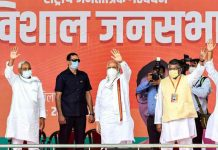 Prime Minister Narendra Modi, Bihar Chief Minister Nitish Kumar (L) and Union Law and IT Minister Ravi Shankar Prasad (R) during an election rally, at the veterinary ground in Patna.
