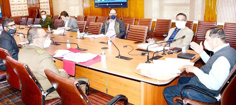 Advisor R R Bhatnagar chairing a meeting on Friday.