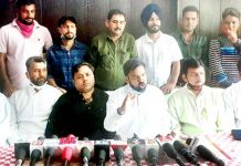 NPP chairman Harsh Dev Singh addressing press conference at Kathua.