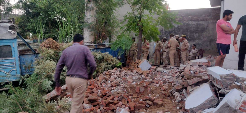Illegal structures being demolished in Vijaypur on Saturday. -Excelsior/Badyal