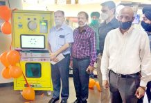 PCB Chairman, Suresh Chugh inaugurating RVM at Wave Mall in Jammu on Wednesday.