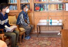 Lt Governor Manoj Sinha meeting J&K topper Basit Bilal Khan on Tuesday.
