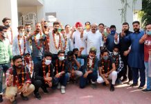 Former MLC and General Secretary PDP Surinder Choudhary posing for photograph with new entrants in party fold at Jammu on Monday.