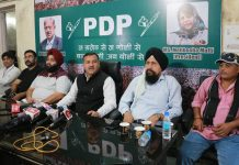 District PDP president, Rajinder Manhas chairing a meeting at Jammu on Friday.