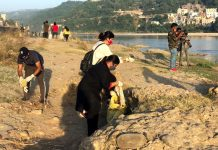 Youth engaged in cleaning river Tawi.