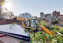 District authorities removing a 40 year old encroachment at Vijaypur on Friday. -Excelsior/Badyal