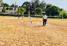 Players in action during the Cricket tournament being played at Railway Ground Jammu.