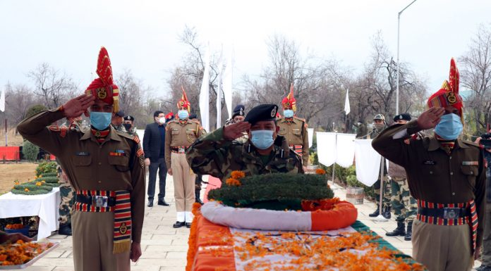 BSF personnel paying tribute to their colleague Sub Inspector Rakesh Dobhal during wreath laying ceremony.