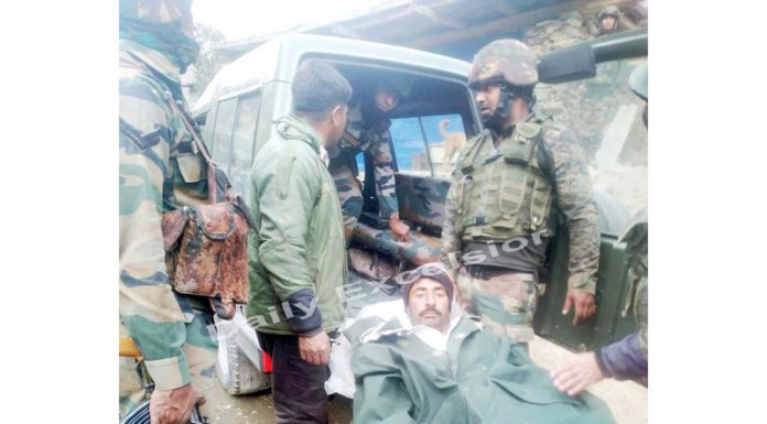 An injured BSF porter being taken to hospital in Poonch on Friday.-Excelsior/ Gurjeetbhajan
