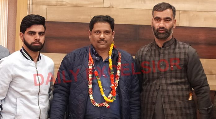 Dy Mayor Pervaiz Qadri (middle) after passing floor test in Srinagar. —Excelsior/Shakeel