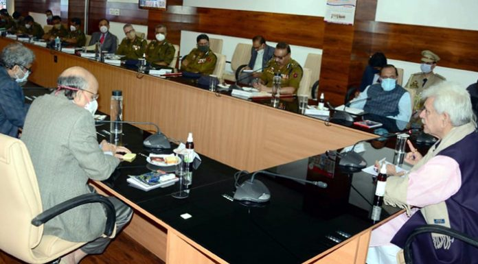 Lieutenant Governor Manoj Sinha reviewing security arrangements with police officers on Tuesday.