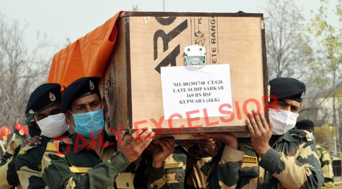 Wreath laying ceremony of BSF jawan who was killed along LoC at Machil sector in Kupwara. -Excelsior/Shakeel