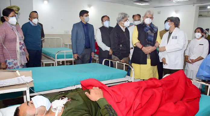 LG Manoj Sinha enquiring condition of the injured jawans in GMC Jammu on Thursday.