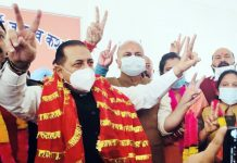 Union Minister Dr Jitendra Singh along with the BJP candidates for DDC election showing victory sign during party workers meeting at Kathua on Sunday.