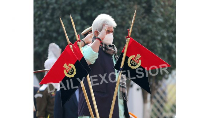 Lieutenant Governor Manoj Sinha takes salute at the guard of honour during opening of Civil Secretariat in Jammu on Monday. -Excelsior/Rakesh