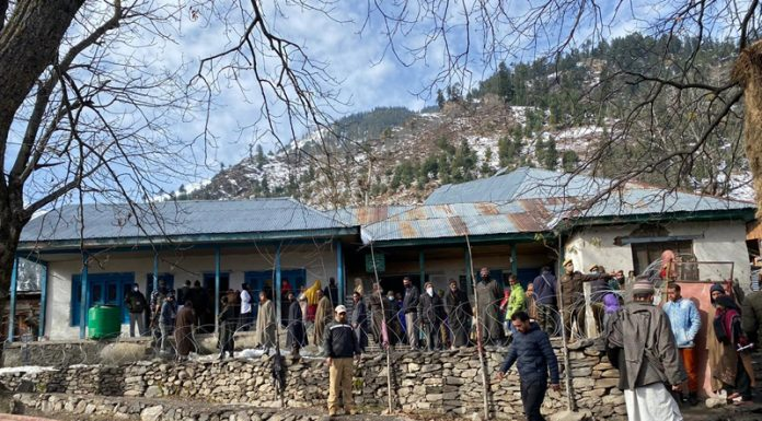 Voters outside a polling station in Marwah area of Kishtwar on Saturday.