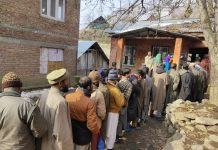 Long queue of voters at a polling booth in Srinagar on Saturday. -Excelsior/Shakeel