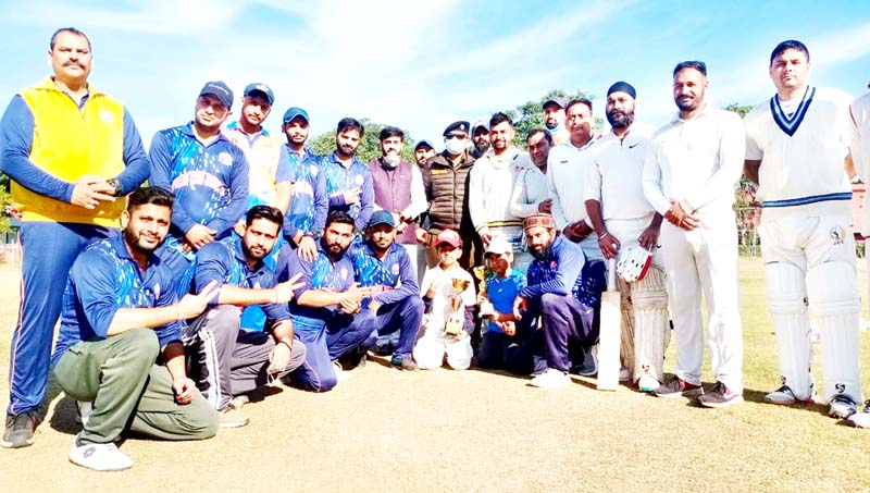 Department of Youth Services and Sports and Press Cricket Club Jammu players posing for photograph with dignitaries at Jammu on Saturday.