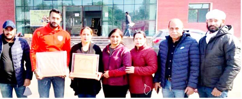 Awardees displaying their mementos after the function at MA Stadium Jammu.