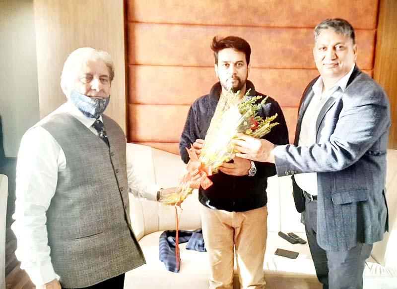 President J&K UT Olympic Association Prof (Dr) Ashutosh Sharma and Secretary General Dushyant Sharma presenting bouquet to MoS Finance Anurag Thakur.