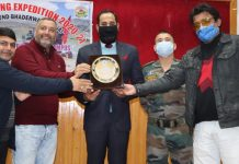 Dignitaries handing over a memento to a person at Bhaderwah on Sunday. —Excelsior/Tilak Raj