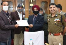 Davinder Pal Singh, Director Police Telecom J&K awarding winner of Debate Competition at Jammu.