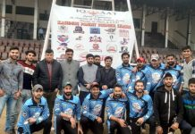 Milchar XI players along with organisers posing with Chairman Nirbya Bharat Foundation, Tarun Uppal at MA Stadium in Jammu.