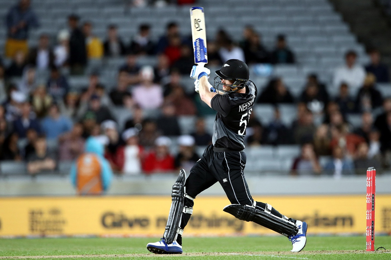 Jimmy Neesham in full flow during T20 match against West Indies.