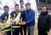 Man of the match being presented to winner during KPPL at MA Stadium Jammu.