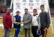 Former first-class cricketer Vimarsh Kaw receiving man of the match award from organisers at MA Stadium on Tuesday.