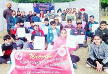 Winning cyclists displaying their meritorious certificates at Udhampur.