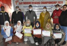 Winners posing for a group photograph alongwith dignitaries at Srinagar on Sunday.