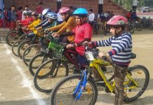 Cyclists posing for a group photograph at Kathua.