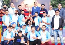 Winning team and dignitaries posing for a group photograph along with title trophy at Jammu.