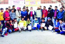 Players and dignitaries posing for a group photograph at Poonch.