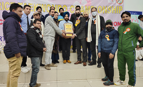 Dignitaries posing a group photograph with title trophy at Poonch.