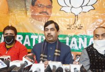 BJP national spokesperson Shahnawaz Hussain addressing a press conference in Srinagar. — Excelsior/Shakeel