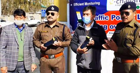 Officers of Traffic Police Leh launching e-challaning on Sunday. —Excelsior/Basharat Ladakhi