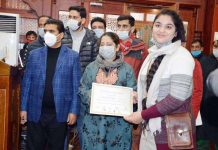 Director Tourism Nisar Ahmad Wani presenting certificate to a participant in Srinagar on Sunday.