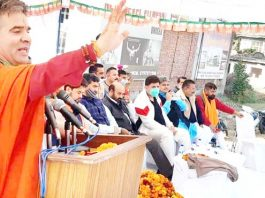 BJP president Ravinder Raina addressing a rally at Mishriwala on Monday.