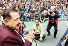 Union Minister Dr Jitendra Singh addressing a public meeting during DDC election campaign in the far-flung area of Ukhral in district Ramban, on Saturday.