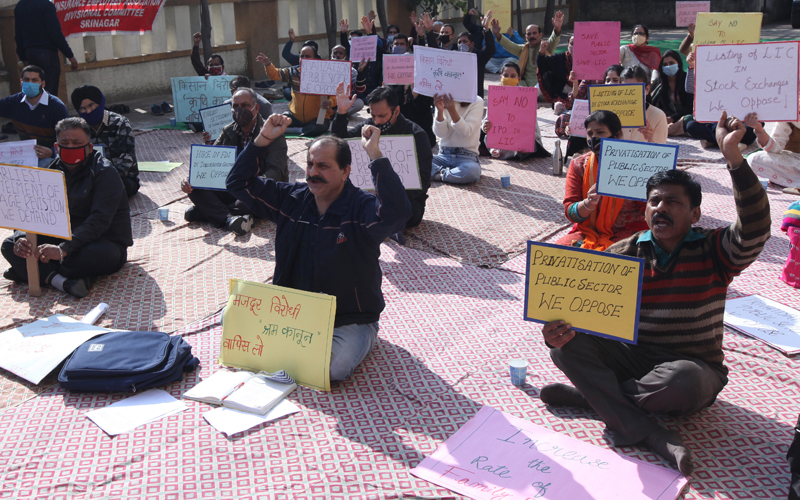 LIC employees staging protest in Jammu on Thursday. — Excelsior/Rakesh