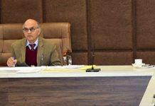 SEC K K Sharma interacting with DCs of Jammu Division through video conferencing on Wednesday.