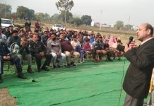 Senior Congress leader, Mohinder Bhardwaj addressing a gathering in Bishnah area on Monday.