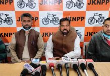 NPP chairman Harsh Dev Singh addressing a press conference in Jammu on Tuesday.