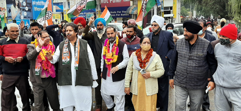 Senior Congress leader and Former Minister Raman Bhalla accompanying Romesh Mottan for filing nomination papers for RS Pura DDC seat.