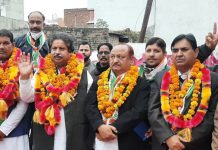 Senior PCC leader, Raman Bhalla with party candidates at election rally at Bishnah.